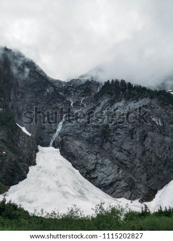 Black mountain, snow with ash from the volcano. Valuable rocks in the state of Washington. #1115202827
