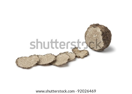 Black winter truffle truffle and slices on white background