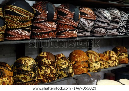 """Blangkon"" is a headgear made from batik and used by men as part of traditional Javanese clothing, usually use as tourist souvenir"