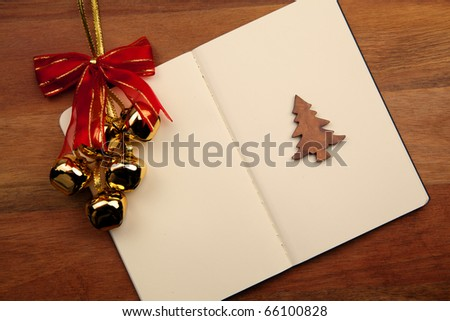 Blank Notebook With Christmas Bell And Tree On Wooden Background