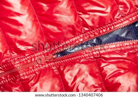 ฺBlue and red full zipper windbreaker down jacket, rain proof down jacket. Down jacket sport shiny nylon full zip isolated on white. #1340407406