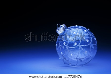 blue Christmas ball on blue background