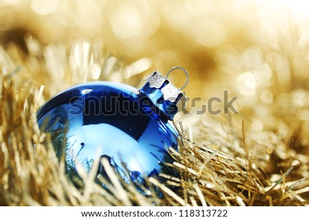blue christmas ball on golden background