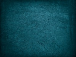 Blue green decorative abstract background. Texture of plastered concrete wall. Grunge background. The combination of the texture of a grainy rough surface and dark turquoise color.