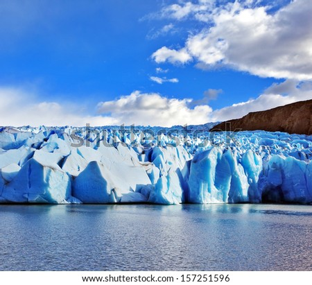 Blue Ice Glacier Gray is reflected in the lake. Journey to the End of the World. Chilean Patagonia in the sunlight