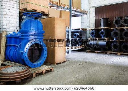 blue metal shut-off valve for gas pipelines. Sliding knife gate valve Shutoff and control valves. boxes. fitting. Warehouse of pipe factory.