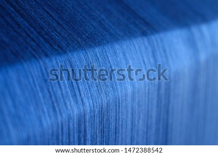 ฺBlue silk on a warping loom of a textile mill, Silk for weaving on a hand loom, Hand Made Silk Process, Close up macro detail of Yarn thread lines running in the weaving loom machine.