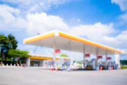 Blurred and soft of gas station with blue sky.