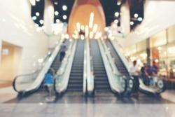 ฺBlurred image of large modern luxury escalators for 4 way with staircase at airport or shopping mall or business office hall with vanishing escalators.