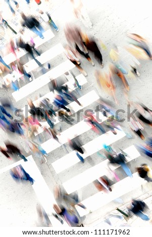 blurred pedestrians crossing