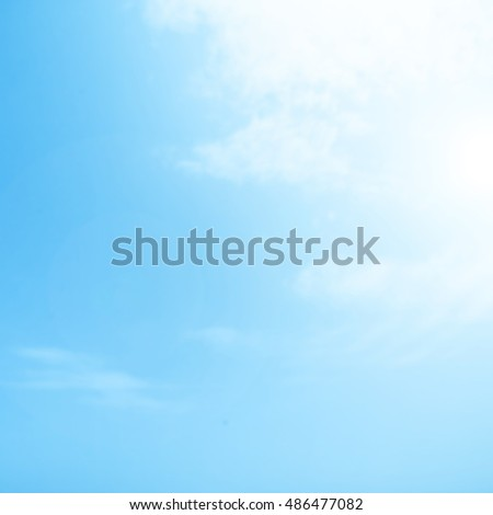 Blurry Cloudy blue sky abstract background with sun beam