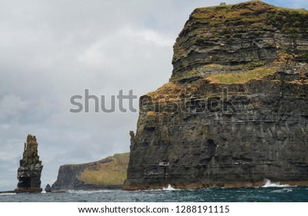 Boat trip on the Cliffs of Moher. The Cliffs of Moher are the best known cliffs in Ireland. They are located on the southwest coast of Ireland's main island in County Clare near the villages Doolin.