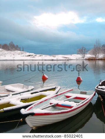 Boats under snow - stock photo
