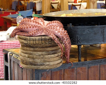 boiled octopus and preparation national meal at restaurant of Barcelona during spring fair