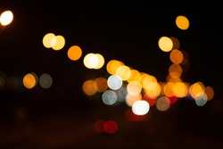 Bokeh on a black background, burning lights. Background from the lights. Christmas background