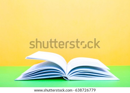 book, Open book on a yellow background #638726779