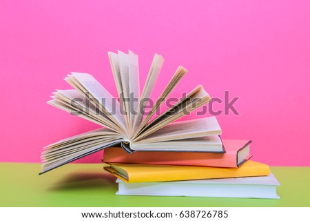 book, Open book on a yellow background #638726785