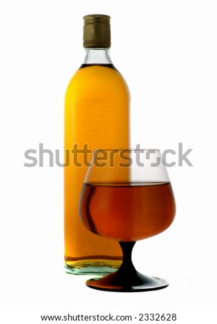 Bottle and glass isolated on white with cognac