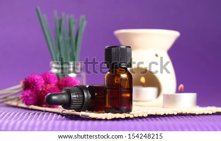 2 bottles of essential oil, aromatherapy burner and candles. Let\'s go spa!