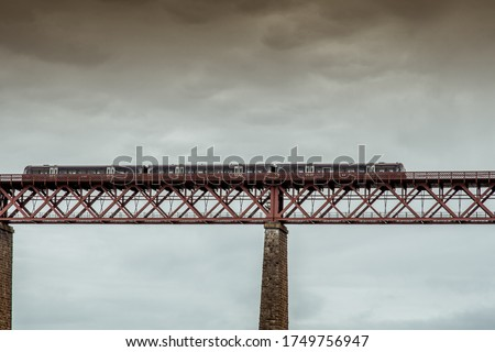 bottom view of a train crossing the steel bridge