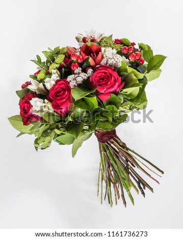 bouquet of exotic flowers with red roses isolated #1161736273