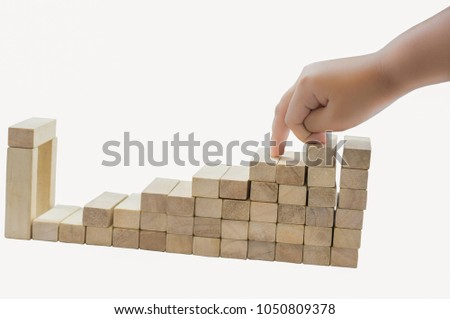 Boy hands, wooden blocks on a white background. Finger gestures up and down with abstract ideas in the world of business competition. #1050809378