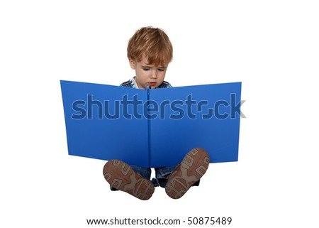 boy studying photography in a big album