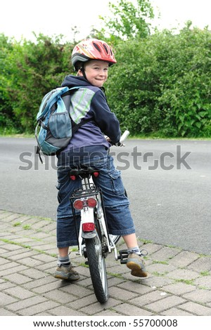 boy with his bicycle