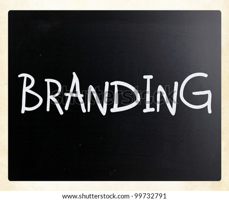 """Branding"" handwritten with white chalk on a blackboard"