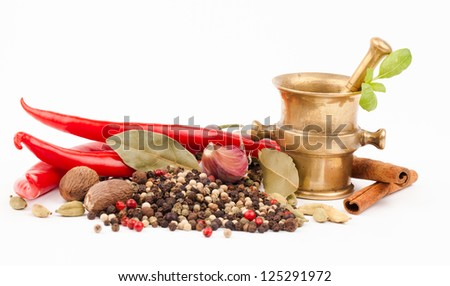 brass mortar with spices isolated on white