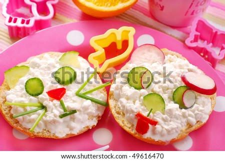 breakfast for child with cat and dog shape sandwich