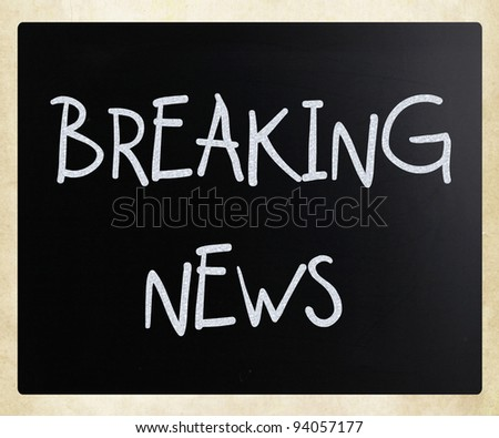 """Breaking news"" handwritten with white chalk on a blackboard"