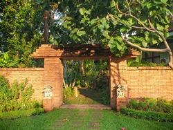 Brick door facade entrance in the park.