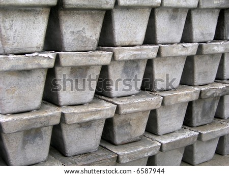 Bricks and blocks of iron just after casting in the factory blast furnace - stock photo