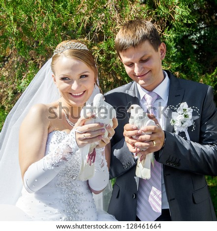 bride and groom are kept in the hands of the whites