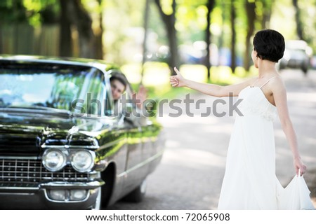 bride  near  car  after their wedding ceremony
