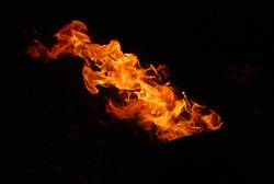 Bright flame of fire on a black background