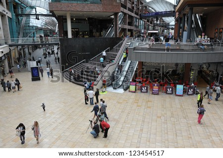BRISTOL - SEPT 21: Shoppers walk through the newly opened Cabot Circus shopping centre on Sept 21, 2012 in Bristol, UK. Cabot Circus boasts 1,000,000 sq ft of retail outlets and leisure facilities.