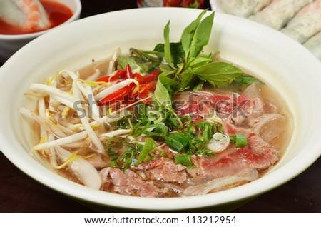 broad rice noodles soup with beef