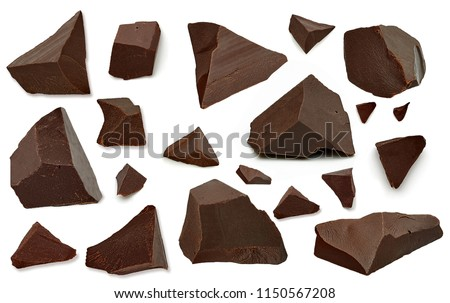 Broken chocolate pieces  or morsels / cracked chocolate parts from top view isolated on white background