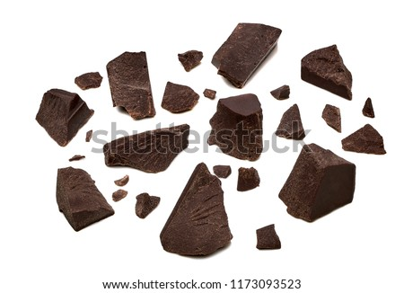 Broken, cracked chocolate pieces or parts isolated on white background