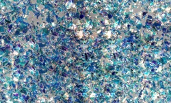 Broken glass texture background. multi-colored foil, glass fragments