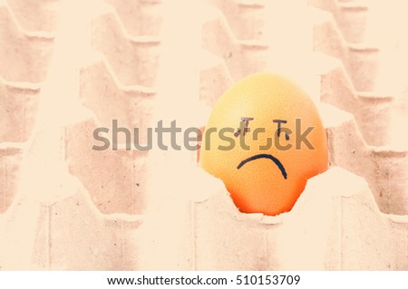 brown eggs face crying arranged in carton #510153709