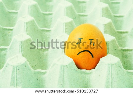 brown eggs face crying arranged in carton #510153727