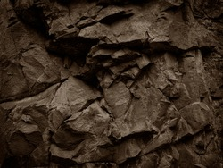 Brown stone background. Mountain texture close-up. Brown rock grunge background.