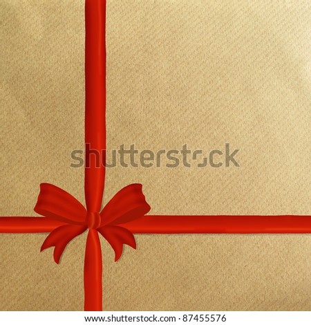 Brown wrapping paper with a red ribbon and bow and copyspace