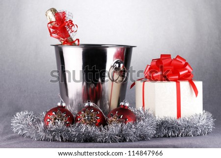 bucket with champagne bottle  and garland. christmas symbols