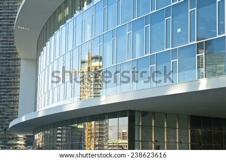 Building construction skyscraper site crane reflected on the glass windows