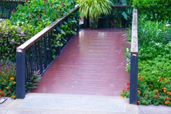 Building wooden entrance with ramp for disabled person wheelchair in park