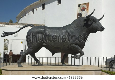 Bull statue in front of the bullfighting arena in Ronda, Spain - stock photo